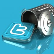 3d illustration of a metallic blue Twitter logo spilling out of an overturned trash can on a blue reflective surface